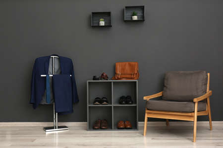 Hallway interior with stylish furniture, clothes and accessories