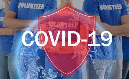 Volunteers uniting to help during COVID-19 outbreak, closeup. Shield and world globe illustrations against group of people
