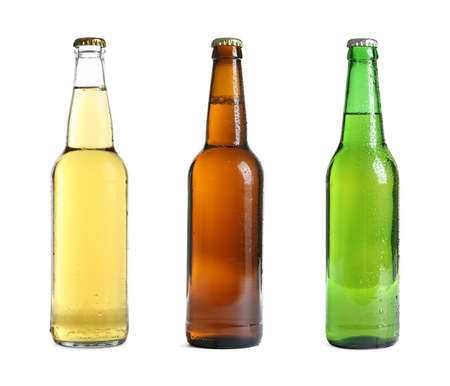 Set with different bottles of beer on white background
