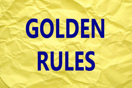 Sheet of color crumpled paper with phrase GOLDEN RULES Foto de archivo