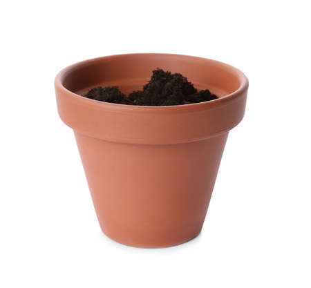 Stylish terracotta flower pot with soil isolated on white 写真素材
