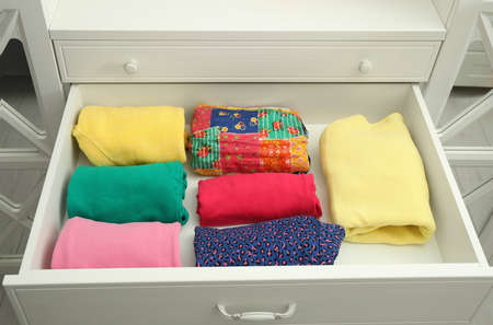 Folded clothes in open drawer. Apparel storage Zdjęcie Seryjne