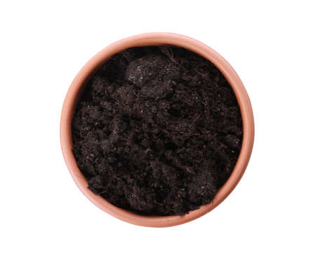 Stylish terracotta flower pot with soil isolated on white, top view