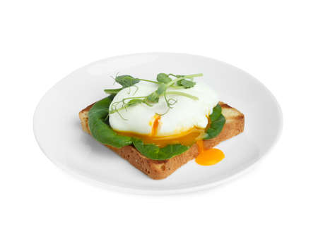 Delicious poached egg sandwich isolated on white Banque d'images