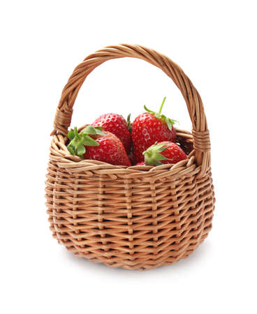 Ripe strawberries in wicker basket isolated on white