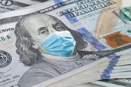 One hundred dollar banknote with face mask, closeup Reklamní fotografie