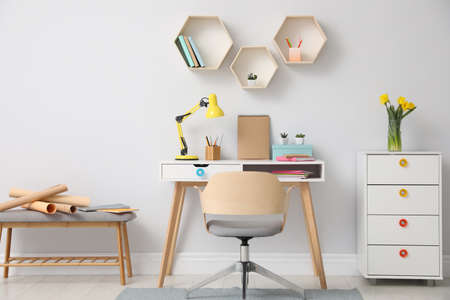Stylish room interior with modern comfortable workplace