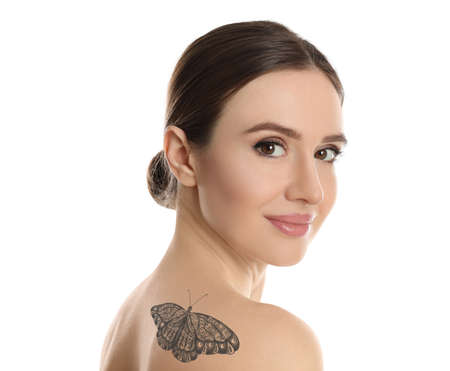 Young woman with beautiful tattoo of butterfly on her body against white background
