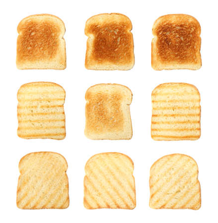 Set of toasted bread slices on white background, top view