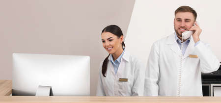Professional staff working at reception in modern clinic. Banner design