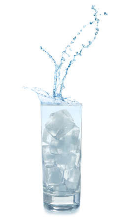 Water splashing out of glass with ice cubes on white background. Refreshing drink