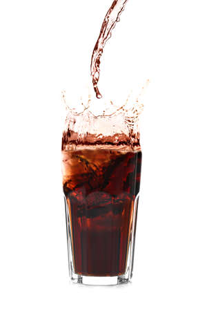 Refreshing drink splashing out of glass with ice cubes on white background Archivio Fotografico