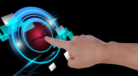 Concept of keywords research and modern technology. Man pointing at key icon on black background, closeup Stok Fotoğraf