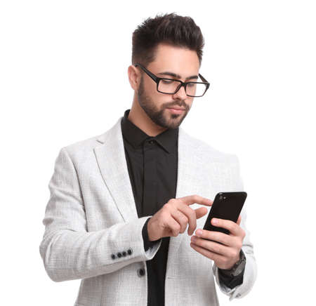 Young businessman with smartphone on white background Banque d'images