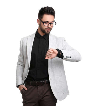 Young businessman checking time on white background Banque d'images