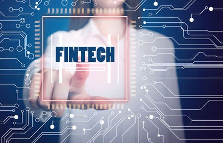 Fintech concept. Woman pointing at icon on virtual screen Banque d'images