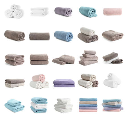 Set of clean soft terry towels on white background