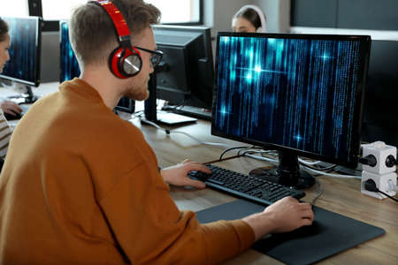 Professional programmer working with computer in office Фото со стока