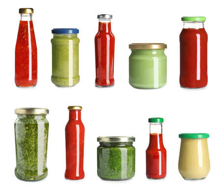 Set with delicious sauces in glassware on white background