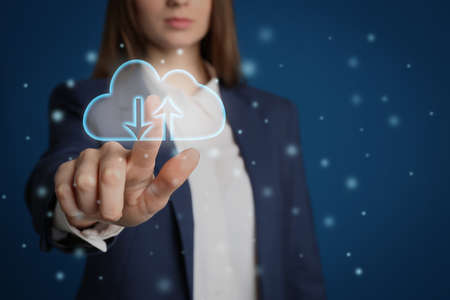 Modern storage technology concept. Woman touching icon of cloud on virtual screen