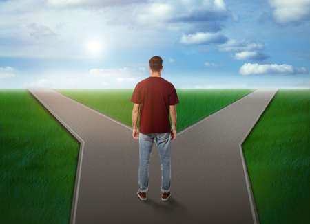 Choose your way. Man standing at crossroads taking important decision