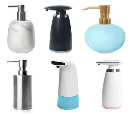 Set of different soap dispensers on white background