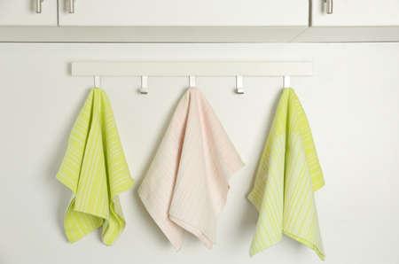 Different kitchen towels hanging on hook rack indoors Banque d'images