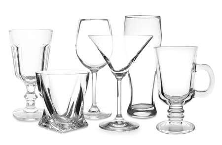Set of empty glasses on white background Stock Photo