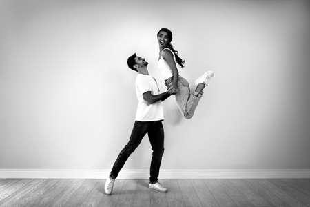 Beautiful young couple dancing in modern studio