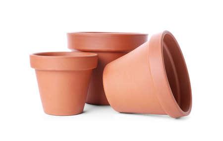 Stylish terracotta flower pots isolated on white