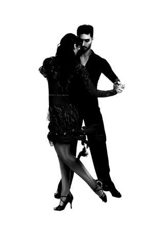 Passionate young couple dancing on white background