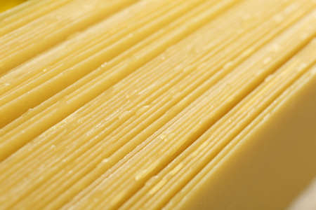 Pile of dry lasagna sheets as background, closeup