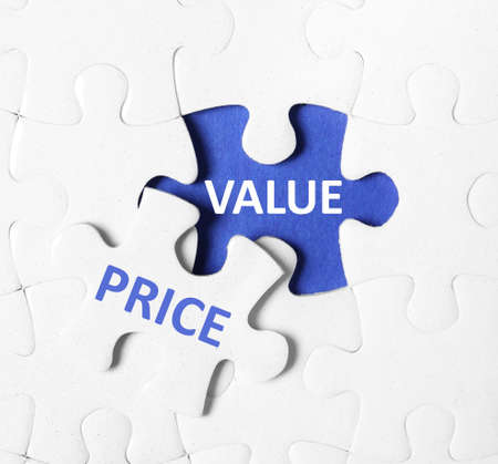 Puzzle with phrase PRICE VALUE on blue background, top view