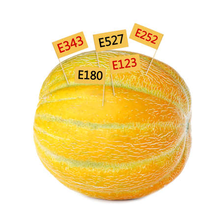 Fresh melon with E numbers isolated on white. Harmful food additives