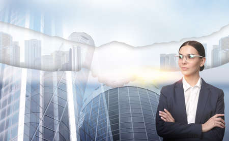 Multiple exposure of businesswoman, partners shaking hands and cityscape