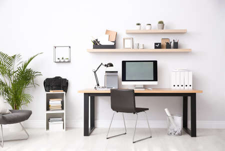 Modern computer on table in office interior. Stylish workplace