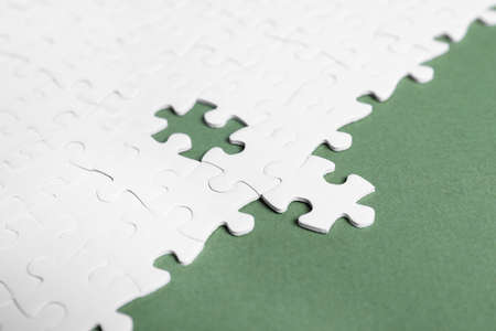 Blank white puzzle pieces on grey background