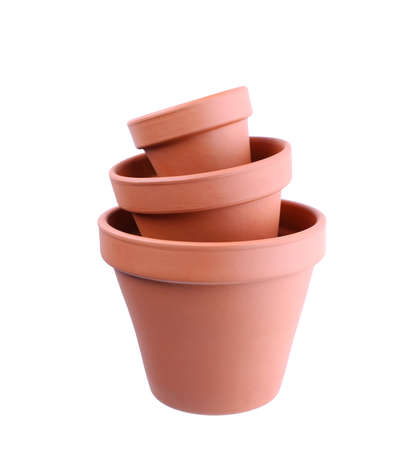Stylish terracotta flower pots isolated on white, top view