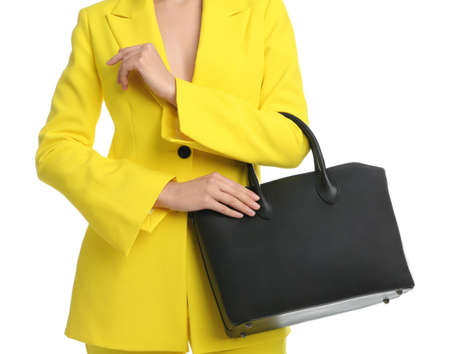 Young woman with stylish bag on white background, closeup Foto de archivo