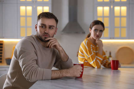 Young couple quarreling at home. Jealousy in relationship