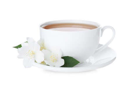 Cup of tea and fresh jasmine flowers isolated on white Foto de archivo