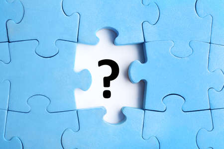 Light blue puzzle with missing piece and question mark on white background, top view