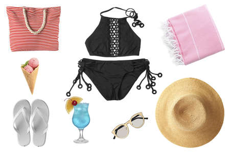 Set of different beach accessories and items on white background