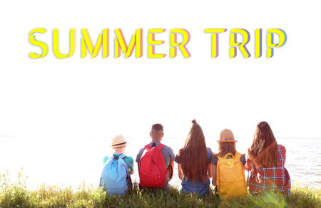 Group of children with backpacks on coast. Summer trip
