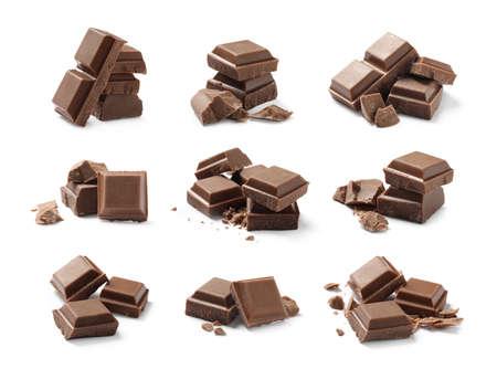 Set with pieces of milk chocolate on white background Stockfoto