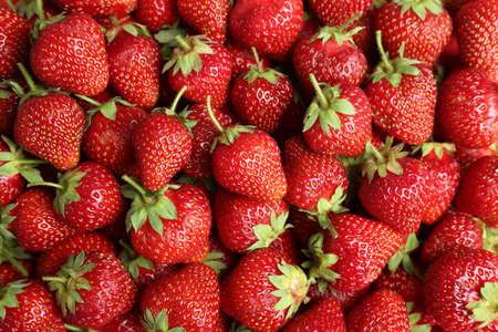 Tasty ripe strawberries as background, top view Stock fotó