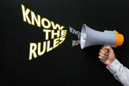 Man using megaphone to say Know the rules, closeup Фото со стока