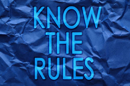 Phrase Know the rules on blue crumpled paper Фото со стока