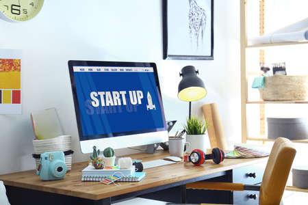 Startup business concept. Workplace with computer in office