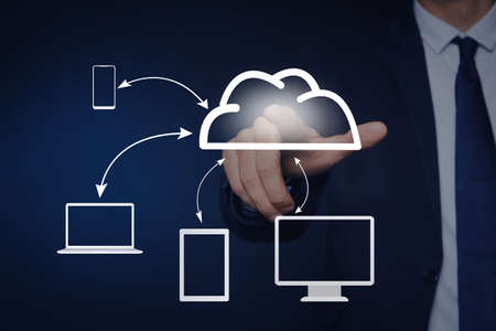 Modern storage technology concept. Man touching icon of cloud on virtual screen 스톡 콘텐츠